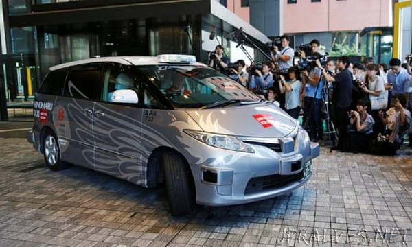 Driverless taxi debuts in Tokyo in 'world first' trial ahead of Olympics